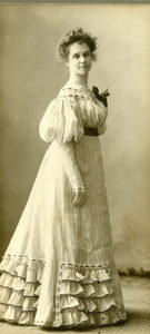 A photo of a woman in a white dress